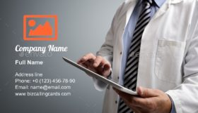 Doctor using digital tablet Business Card Template