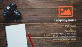 Camera on Wood Desk Business Card Template